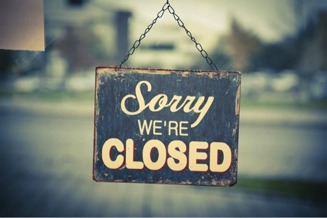 Sign reads Sorry we're closed